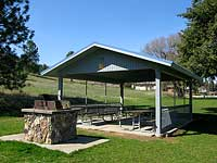 A white wooden picnic shelter.
