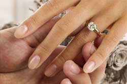 Man Holding Wife's Hand with Wedding Ring