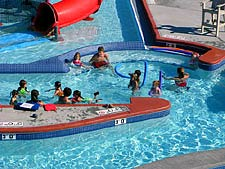 A group of children playing in a pool