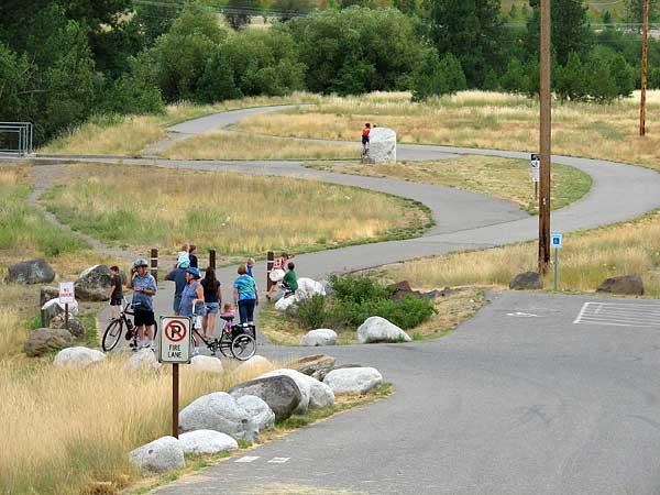 Spokane river centennial trail spokane county wa group of bicyclists on a winding paved trail publicscrutiny Choice Image