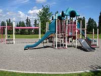 A colorful playground with blue skies above.
