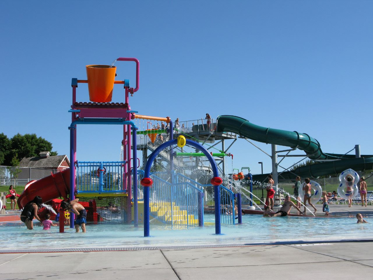 People playing on the Aquatics Center equipment.